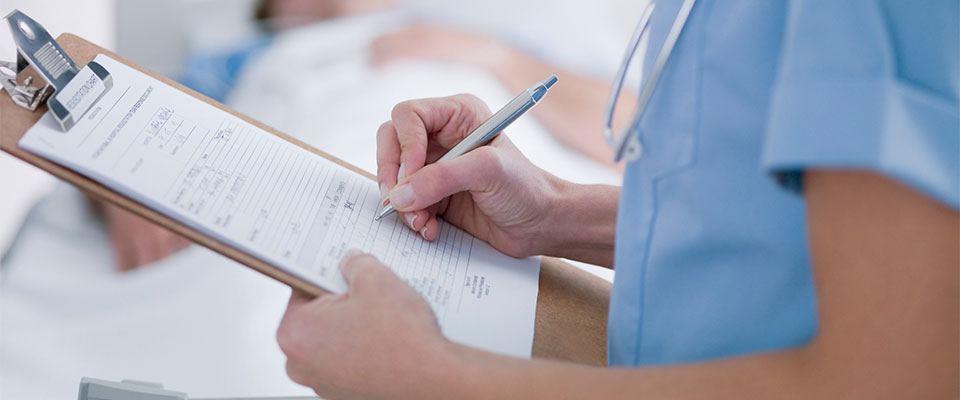 Nurse Holding a Clipboard and Writing